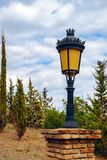 Lamppost in park. With cloudy sky Royalty Free Stock Photo