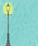Lamppost In the Rain. A lit gaslight in a downpour of heavy rain Royalty Free Stock Photo
