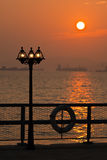 Lamppost in romantic sunset Stock Image
