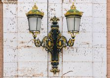 Lamppost in the Royal Palace of Aranjuez, Spain. Baroque, ornamental lamppost with golden colors in the Royal Palace of Aranjuez, Spain Stock Photography