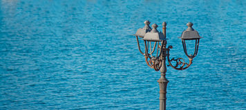 Lamppost by the sea Stock Photos