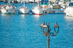 Lamppost by the sea Royalty Free Stock Photography
