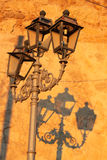 Lamppost. Shadow on ancient wall Royalty Free Stock Photos
