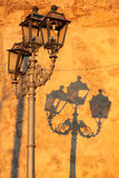 Lamppost. Shadow on ancient wall Royalty Free Stock Photography