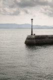Lamppost on the Shore. Lamppost on a pier in northern Spain Stock Photos