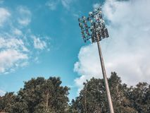 Lamppost and Sky. Lamppost in the track field of the park, stunning clouds and sky royalty free stock photo
