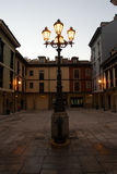 Lamppost in square. Lamppost and place of the Font�n, in Oviedo, Asturias, Espa�a.Corral of comedies of century XVIII Royalty Free Stock Photo
