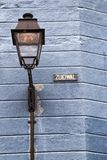 Lamppost. And street-sign on a blue wall royalty free stock images
