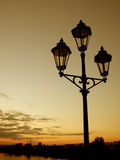 Lamppost at sunset. Lamppost on a bridge, just few moments before being switched on stock photography