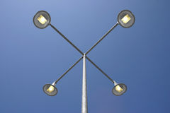 Lamppost under blue skies Stock Photos