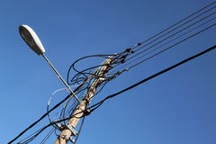 Lamppost with wires Stock Images