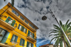 Lamppost and yellow building Stock Image
