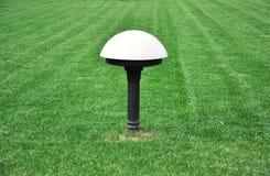 Lamppost z trzy światłami w parku Fotografia Royalty Free