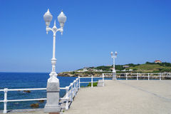 Lampposts and blue sky. White lamppost in the Asturian coast Royalty Free Stock Image