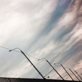 Lampposts and cloudy sky Royalty Free Stock Images