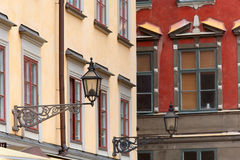 Lampposts on colorful buildings in Stocholm Stock Photos