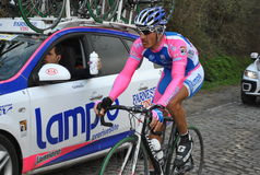 Lampre Cyclist gets something to drink Royalty Free Stock Photography