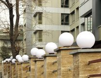 Lamps. On a building courtyard wall Stock Photography