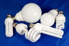 Lamps. Six energy saving fluorescent lamps on blue background Stock Image