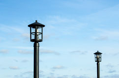 Lamps against the blue skies. Lamp posts against the blue skies Royalty Free Stock Image