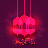 Lamps with Arabic text for Ramadan Kareem. Beautiful pink Lamps with Arabic Islamic Calligraphy of text Ramadan Kareem on floral design decorated shiny Royalty Free Stock Images