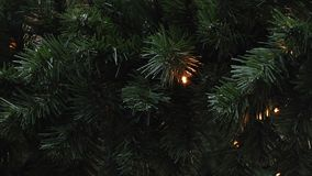 Lamps blink on artificial spruce. New Year and Christmas background. LED garlands. Lamps blink on an artificial dark green spruce. New Year and Christmas stock video