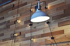 Lamps and bulbs on the cord. Wall design in the cafe.Lamps and bulbs on the cord royalty free stock photography