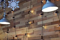 Lamps and bulbs on the cord. Wall design in the cafe.Lamps and bulbs on the cord royalty free stock image