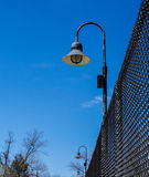 Lamps on Chainlink Fence Stock Photo