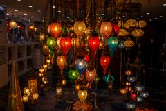 City lights in the store ... The joy of looking!. Lamps and cheeks with colorful joy, eye-catching stained glasses Stock Images