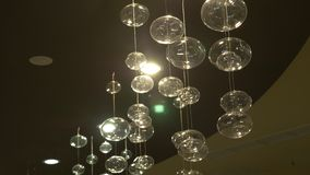 Lamps close-up. Crystal modern chandelier detail background. Hanging lamps in the form of bubbles with a flashing stock video