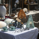 Lamps, cups and spoons and other things on the Spitalfields market near Liverpool Street subway. Stock Images