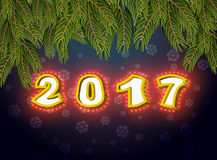 2017 with lamps fir branches. Luminous signboard. Vintage shiny. Lettering bulbs. garland for Christmas and New Year. Retro pointer with light bulb. Glowing Stock Photo