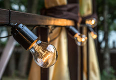 Lamps. Garland of light bulbs. Decoration of summer cafe Stock Image