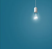 Lamps hanging from above on a blue background Stock Photography