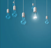 Lamps hanging from above on a blue background Stock Photos