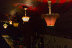 Lamps. Light system in a retro bar royalty free stock images