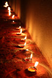 Lamps Line. A background with a beautiful line of traditional lamps lit on the occasion of Diwali festival in India Royalty Free Stock Photos