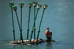 Lamps man. Surreal lamps man on river Po in Turin, Italy Stock Photo