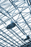 Lamps and metallic girders on glass ceiling Stock Photo