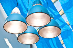 Lamps in modern blue cieling Royalty Free Stock Photos
