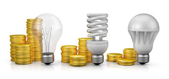 Lamps next to coins Royalty Free Stock Image