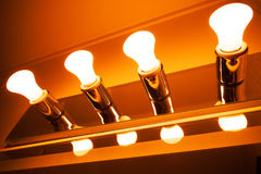 Lamps in a row, modern orange toned illumination Stock Images