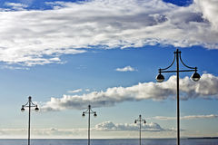Lamps,sky and sea Royalty Free Stock Photo