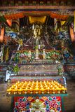Lamps with statue of Guru Rinpoche and deity , inside of chapel , Bhutan stock image