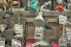 Lamps in the store. Home and office lighting products are displayed on the shelves in a hardware store Stock Photo