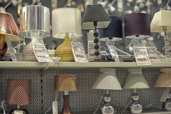 Lamps in the store. Home and office lighting products are displayed on the shelves in a hardware store Stock Photography
