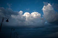 Lamps and an upcoming storm. Luminaries and upcoming storms and sunny clouds Stock Image