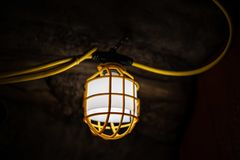 Lamp in the underground cave royalty free stock photography