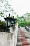 Lamps. Vintage road lamps on stone handrail Stock Photo
